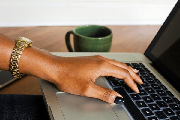 black-woman-hand-on-laptop-createherstock.png