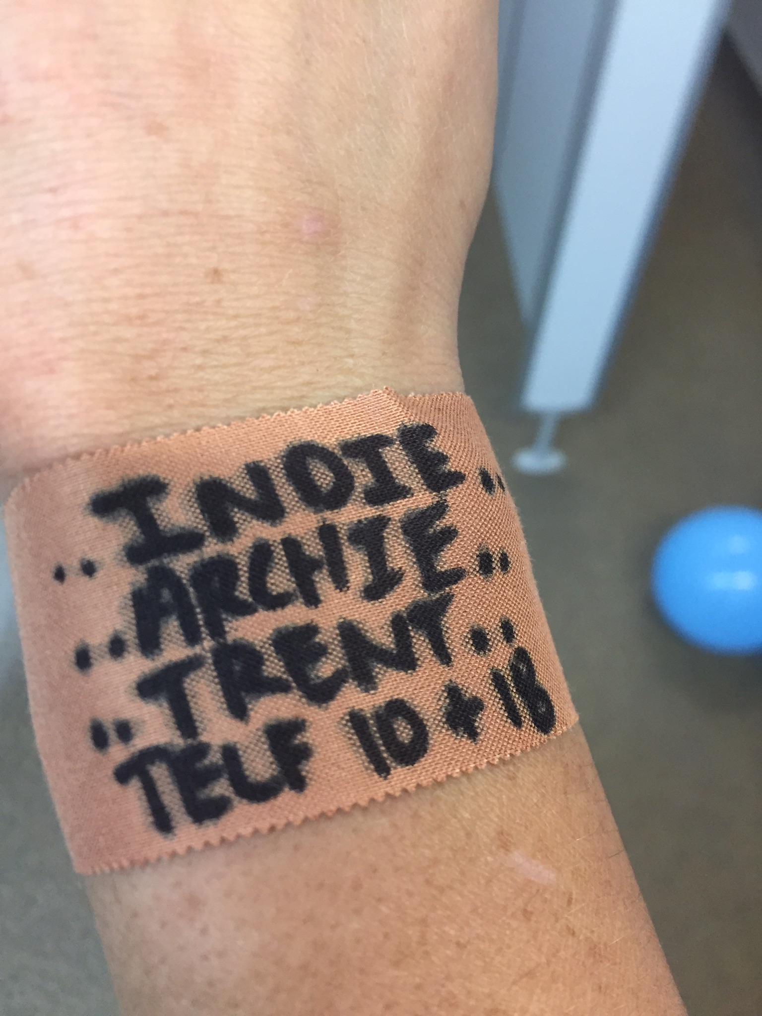 FAMILY - Photo: Wendy Frew writes the names of her loved ones on her wrist before each game. The Telfer clan is expanding rapidly, with those 18 nieces and nephews now 20. Pic: Supplied