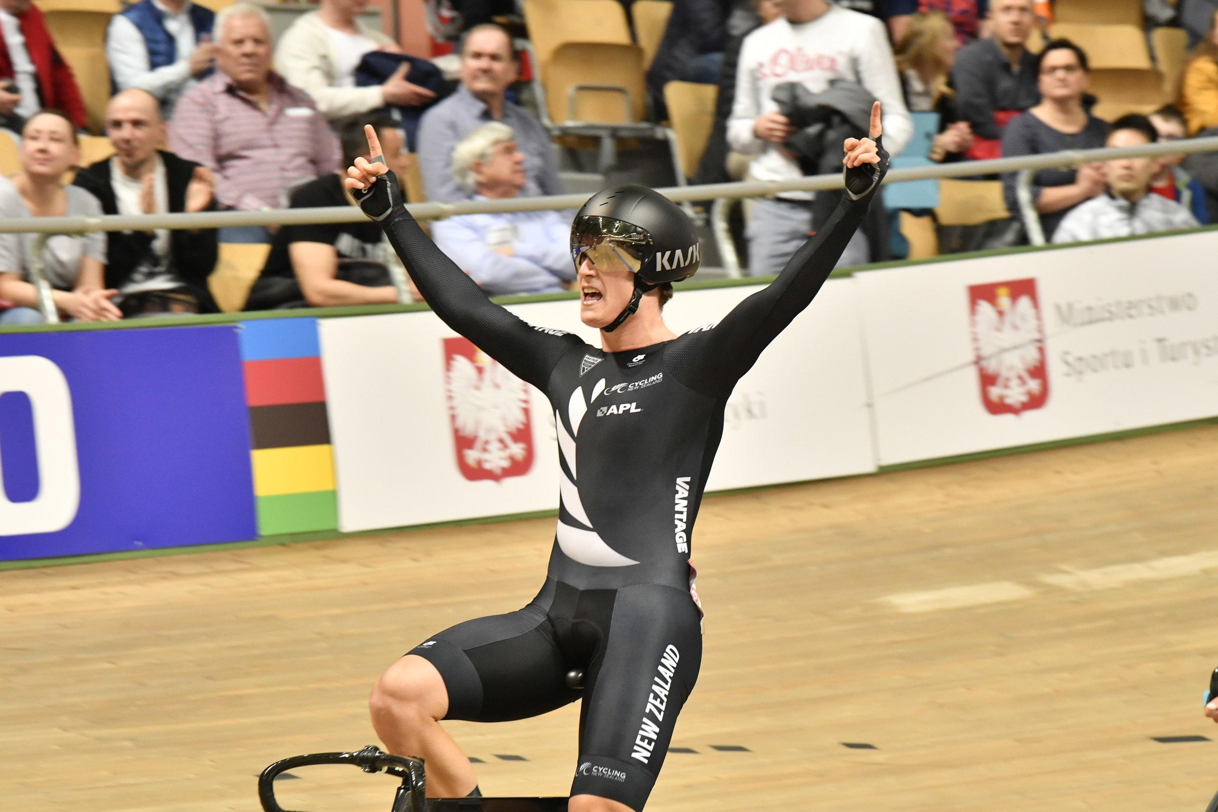 Photo: Campbell Stewart celebrates winning the world omnium title in Poland. Pic: Guy Swarbrick