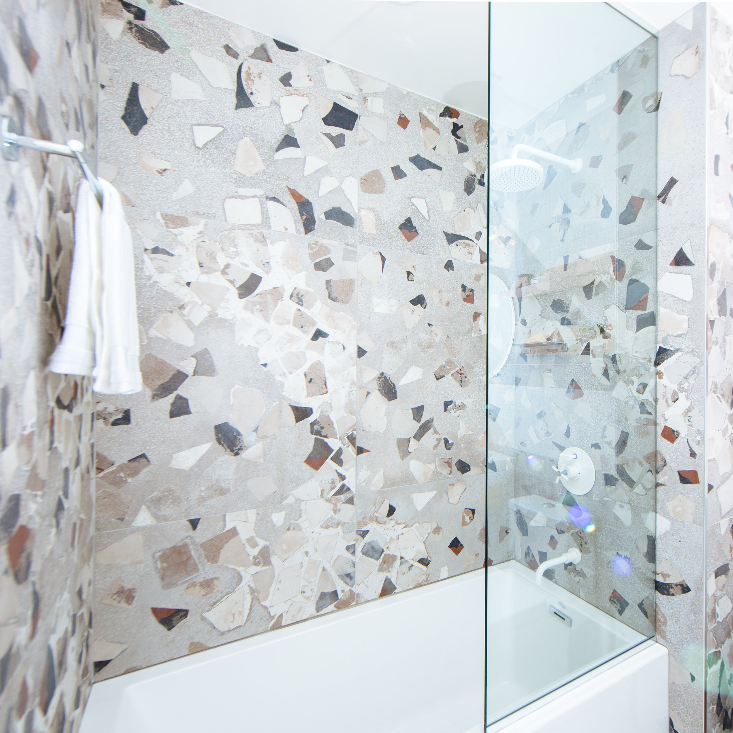 Terrazzo shower white fixtures futuristic interior design