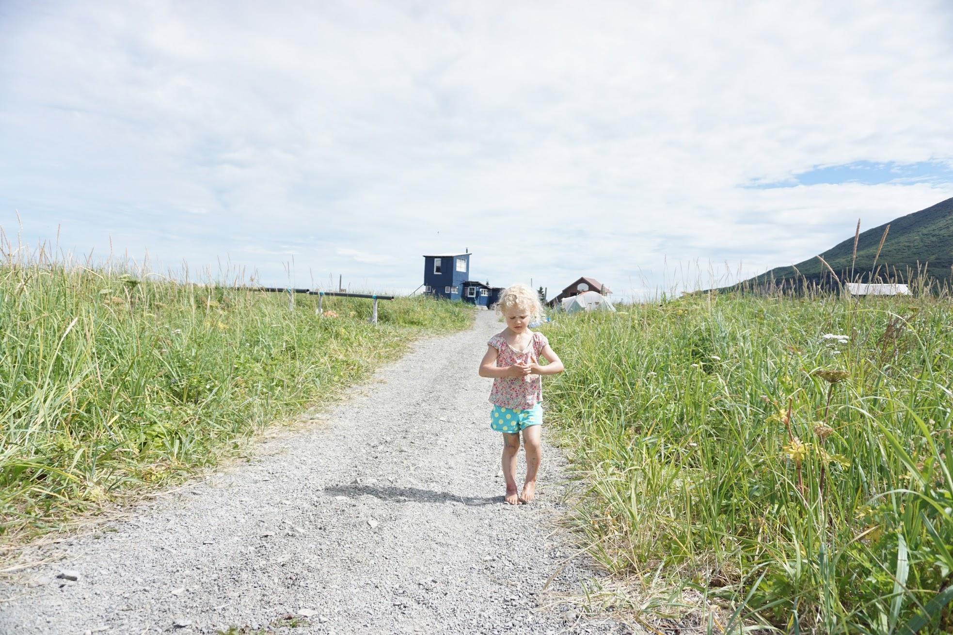 Lila walking fish camp.JPG