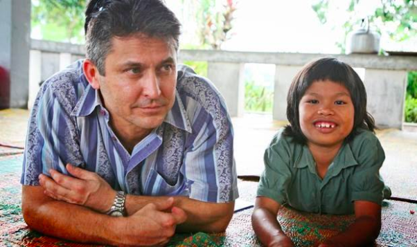 Randolph and an orphanage child in Sumatra, Indonesia.