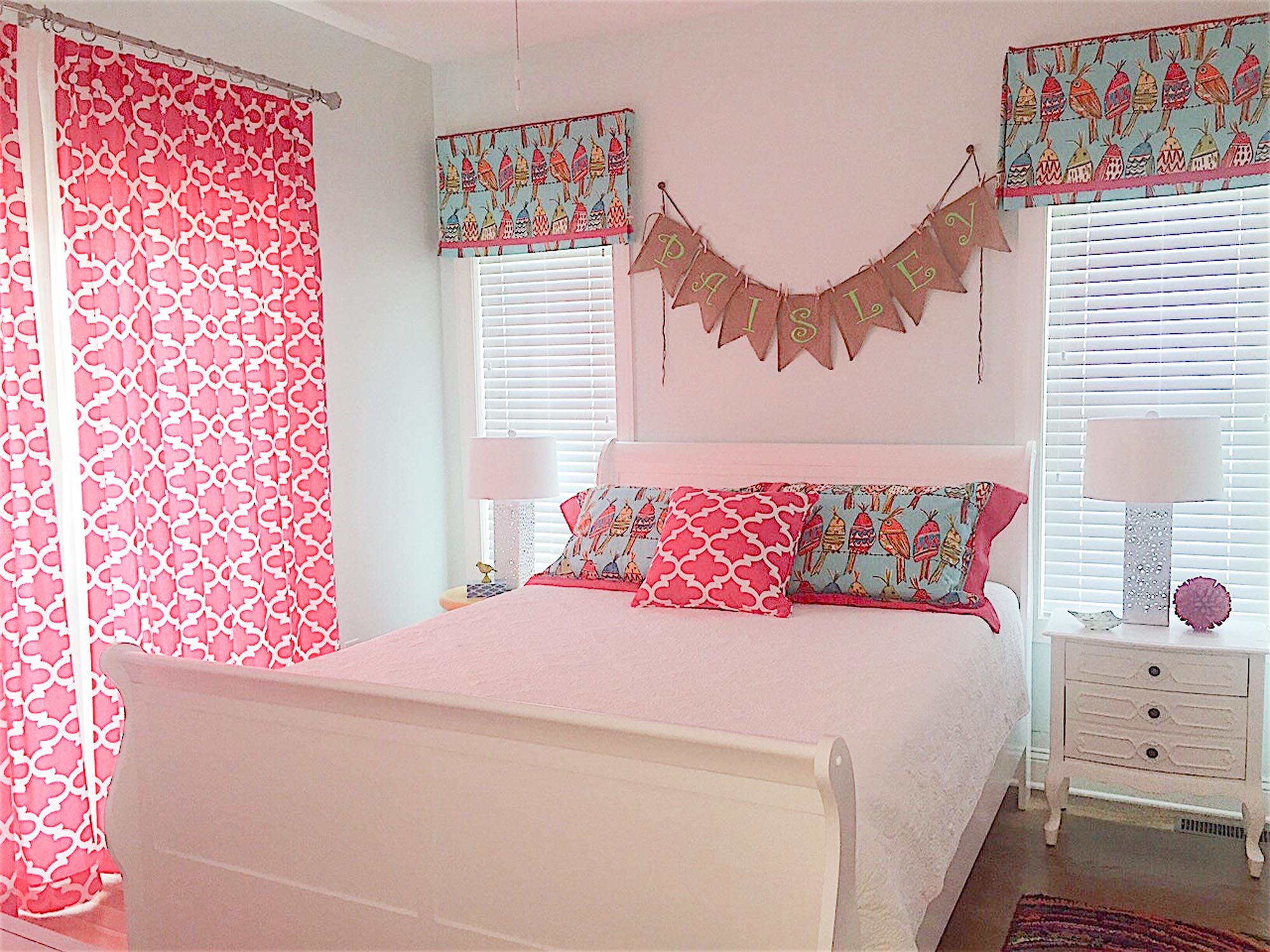 Pink bedroom for a girl with bird valances
