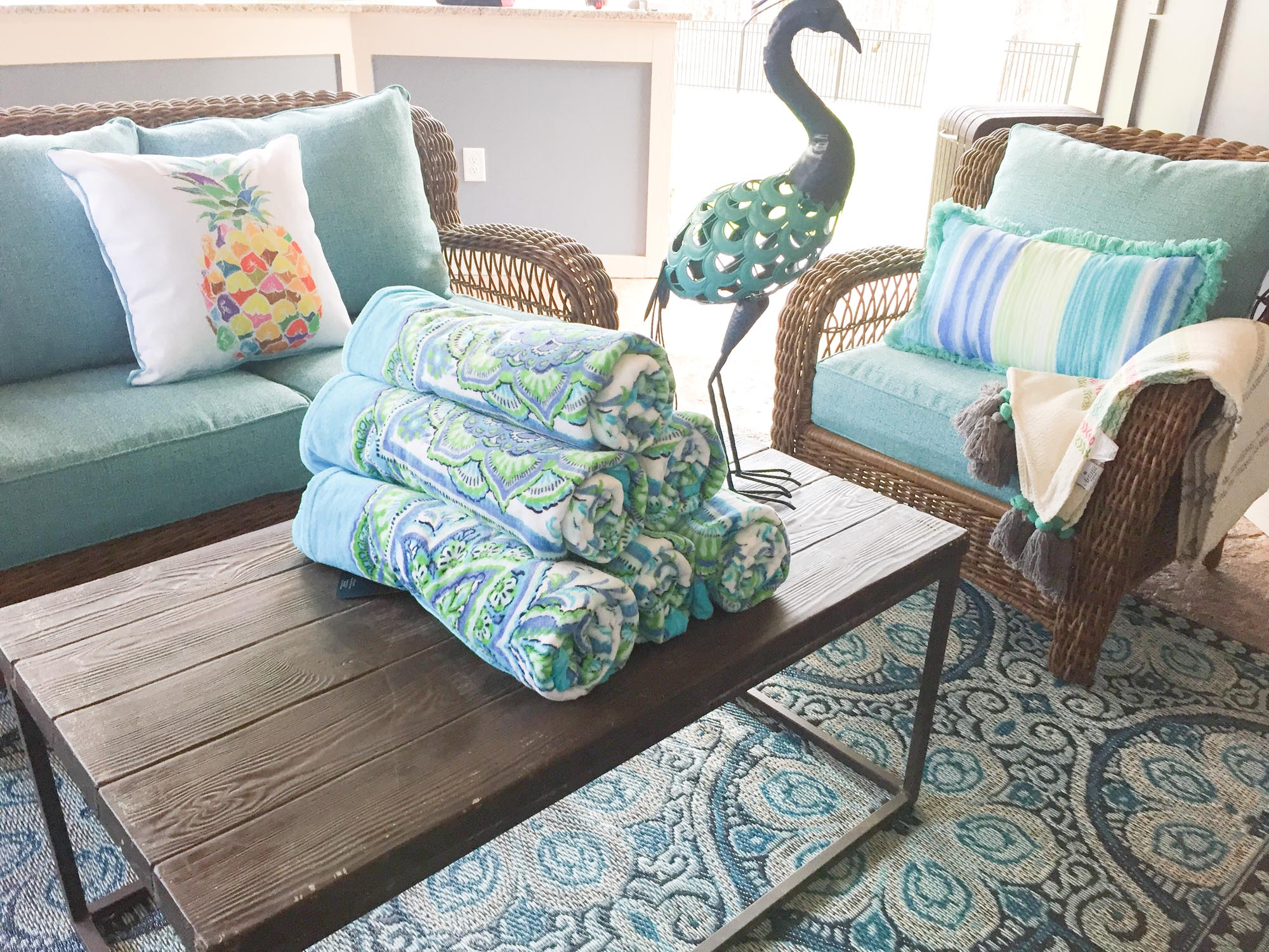 Outdoor seating area with pineapple print pillow