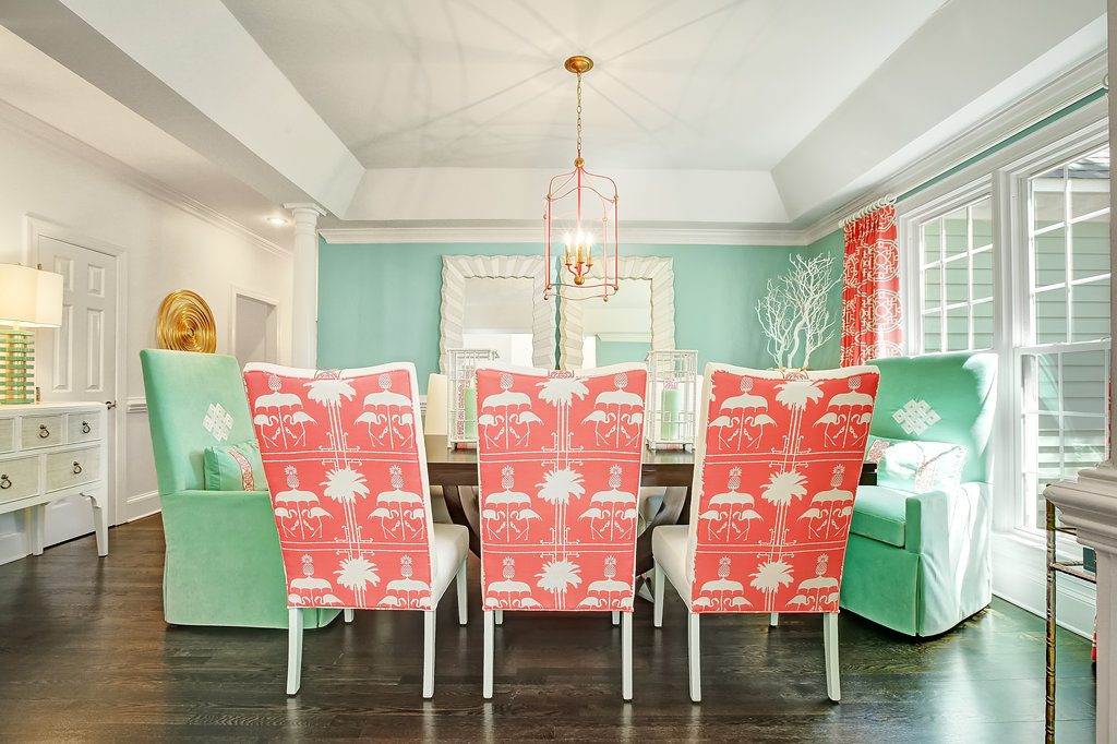 Bright dining room with pink flamingo upholstered chairs