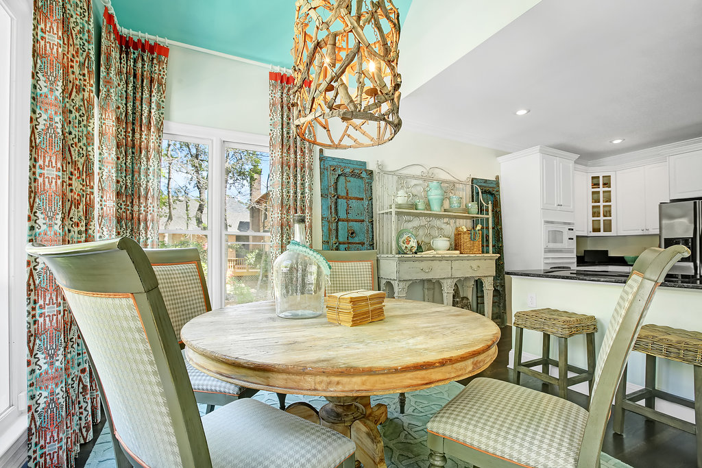 Colorful breakfast room with driftwood chandelier