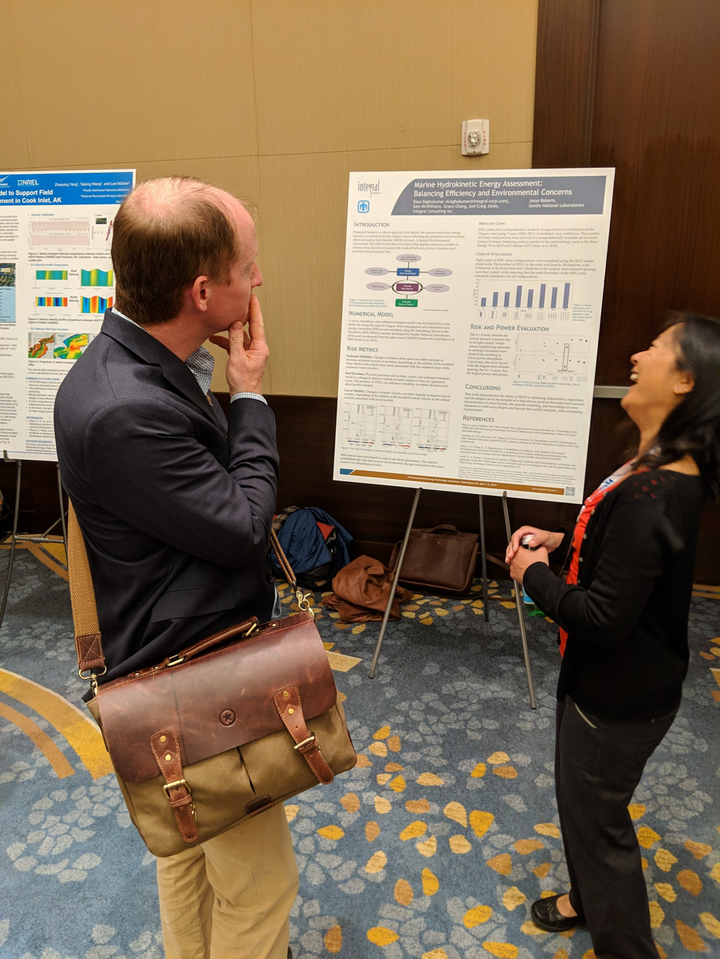James Joslin touring the METS poster session