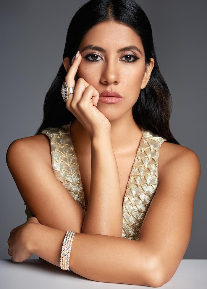 "(Pictured: Stephanie Beatriz. Credits: ""Brooklyn 99"")."