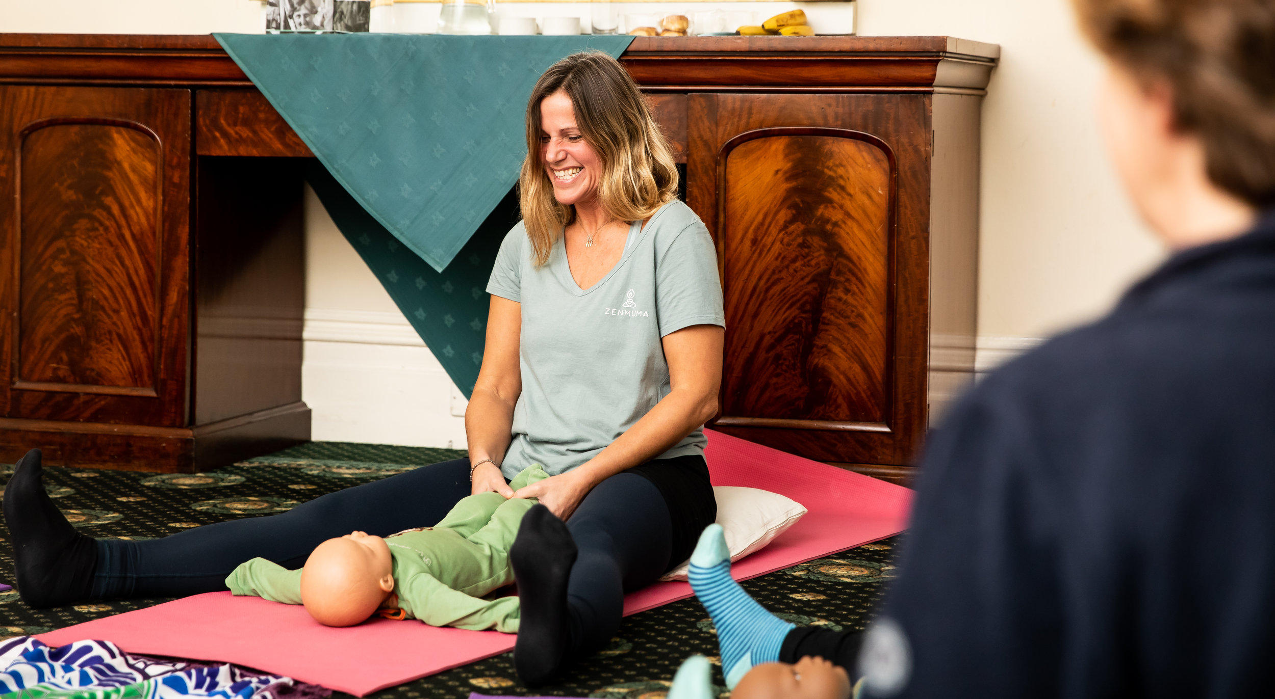 train with us! - Become a baby yoga and massage instructor with ZenMuma! Help mums bond with their babies, all while helping improve the baby's mobility and motor-skills through gentle movement and song.