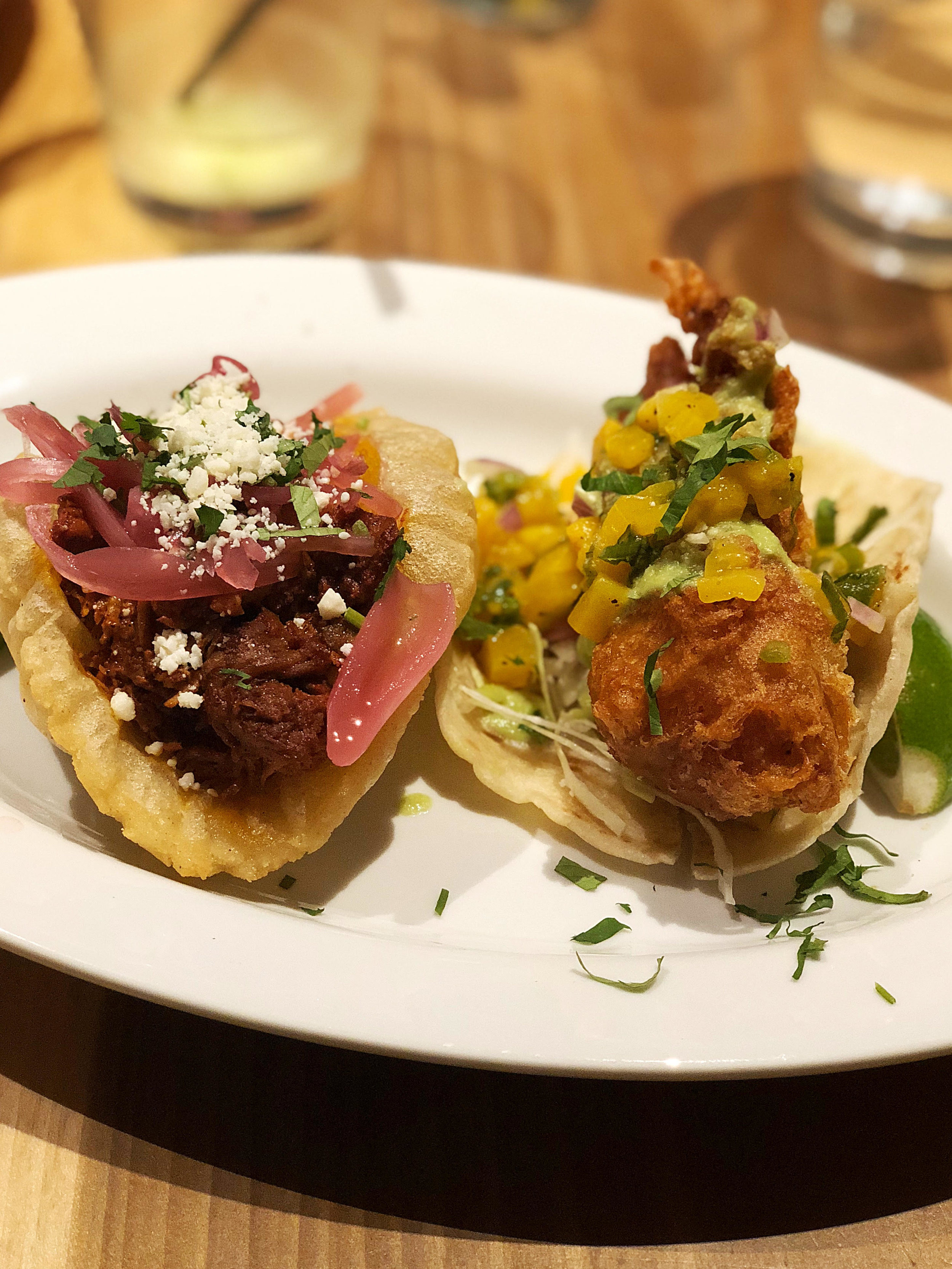 Puffy pork and fried fish taco