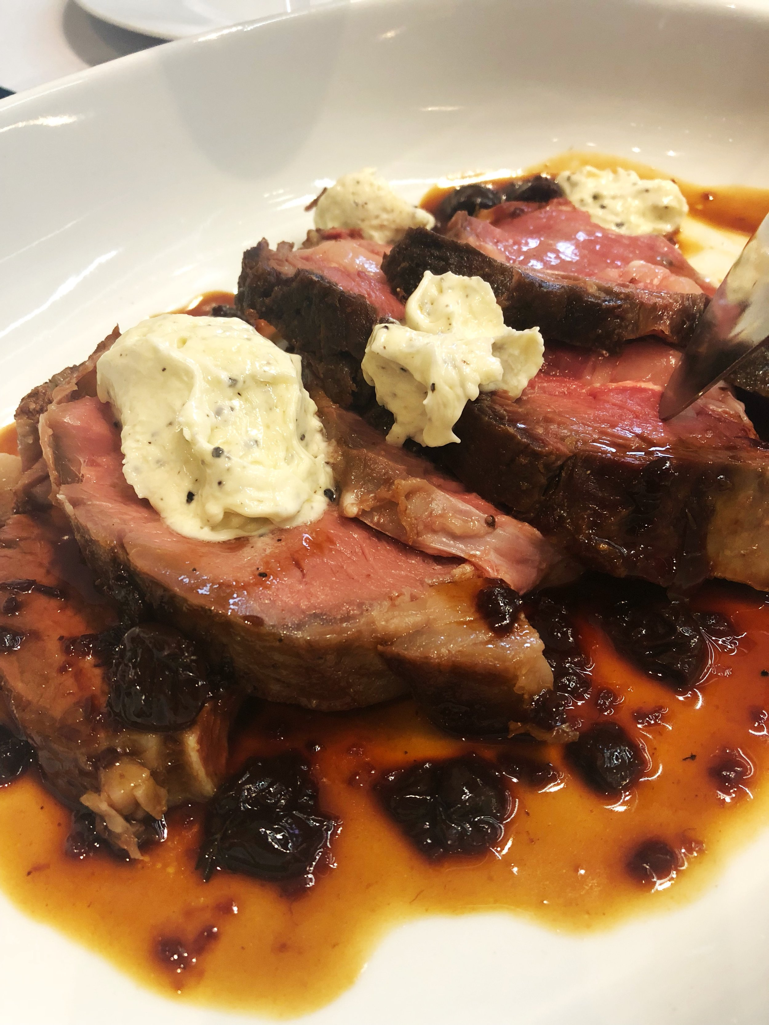 Prime rib with truffle butter and cherry bordelaise from Angie Mar of The Beatrice Inn