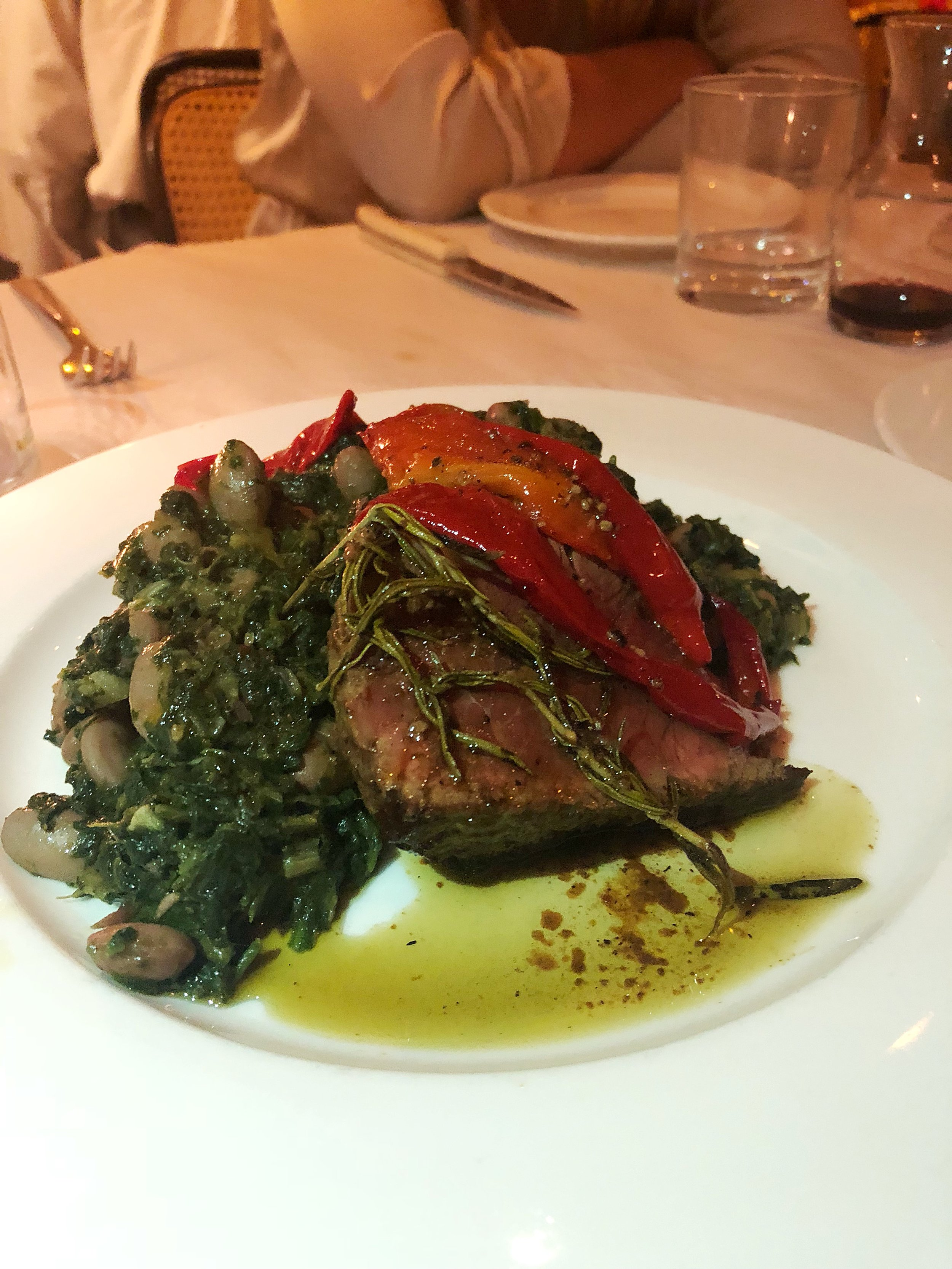 Sirloin over rosemary branches and peppers