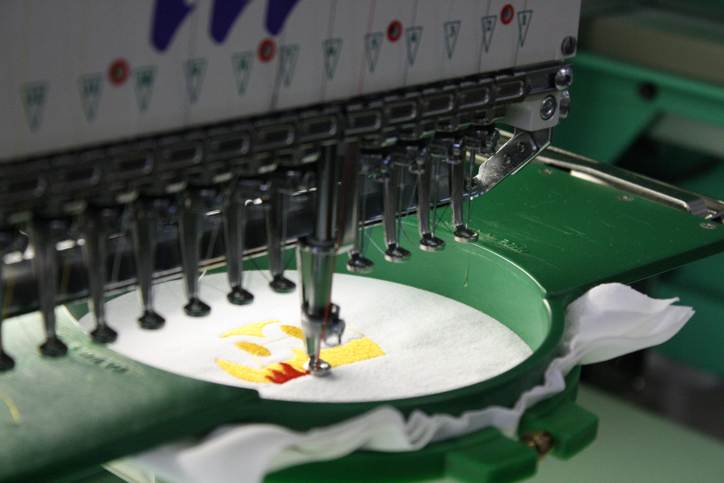 A Tajima embroidery machine sewing out a design.
