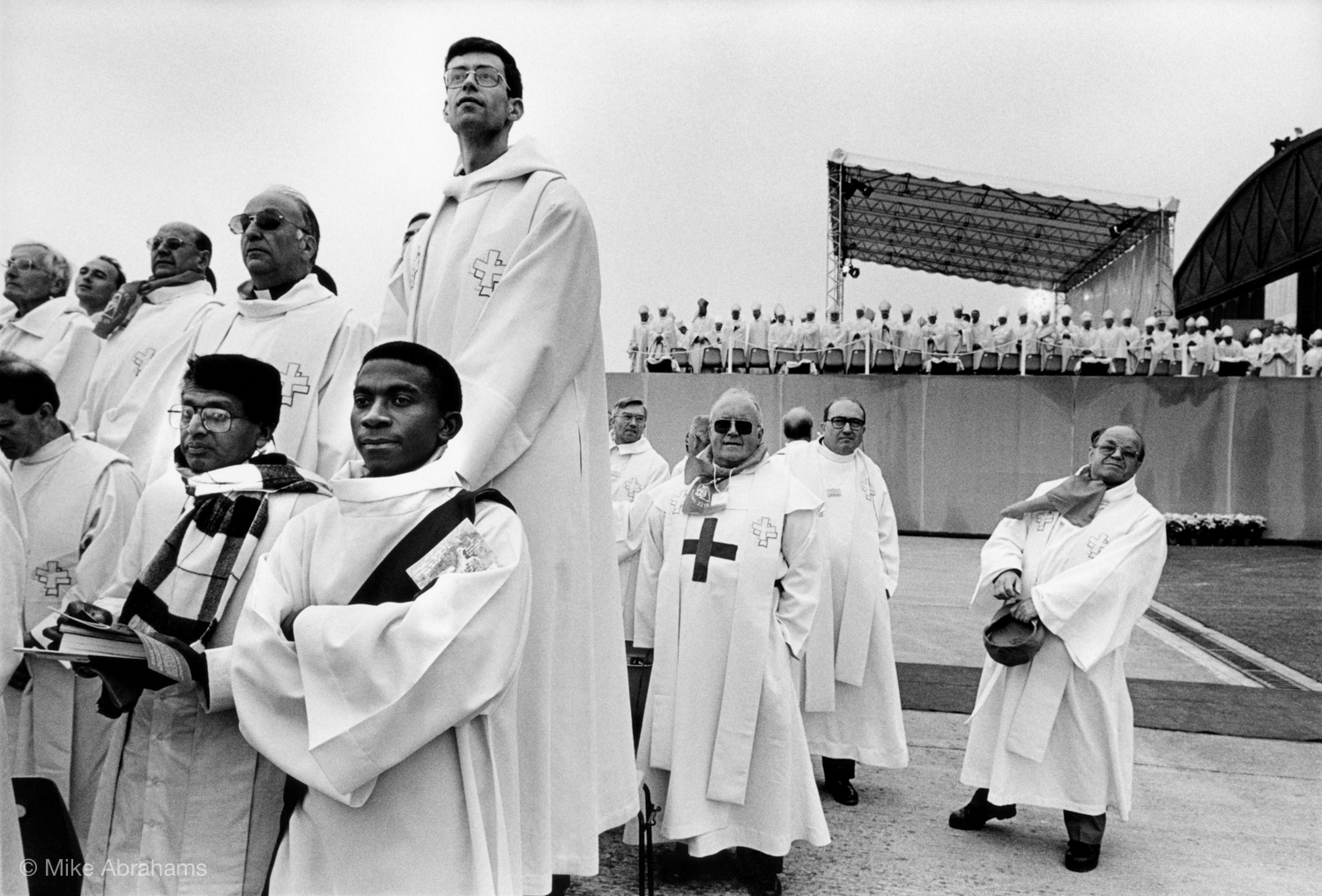 Catholic priests awaiting the arrival of the Pope. 200,000 people attend an open air mass at Reims. France 1996