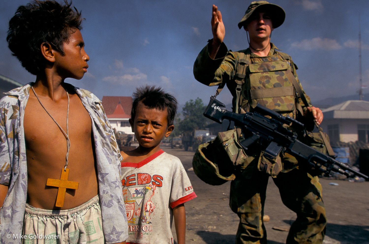 East Timor, September 1999: Displaced East Timorese children take refuge in a camp in Dili protected by Australian troops.