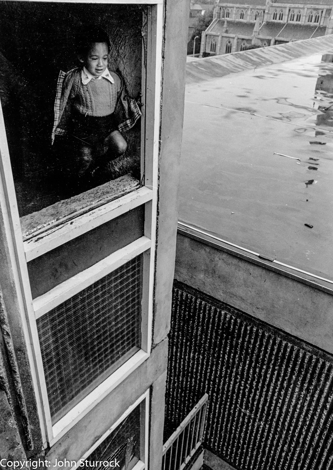 Dangerous stairwell in council flats, Moss Side, Manchester 1974