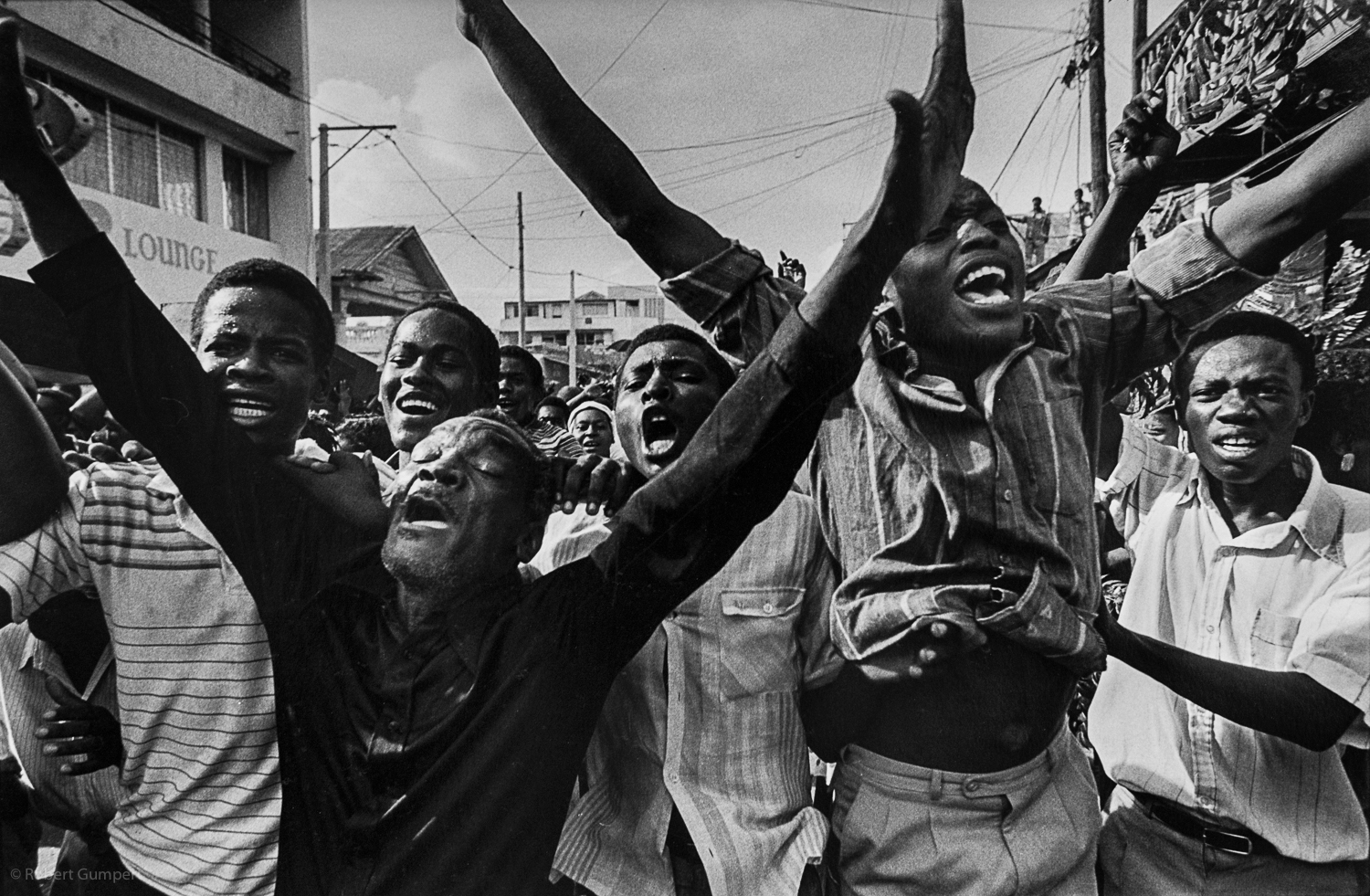 Haiti, 1990:  Aristide supports march in downtown Port au Prince