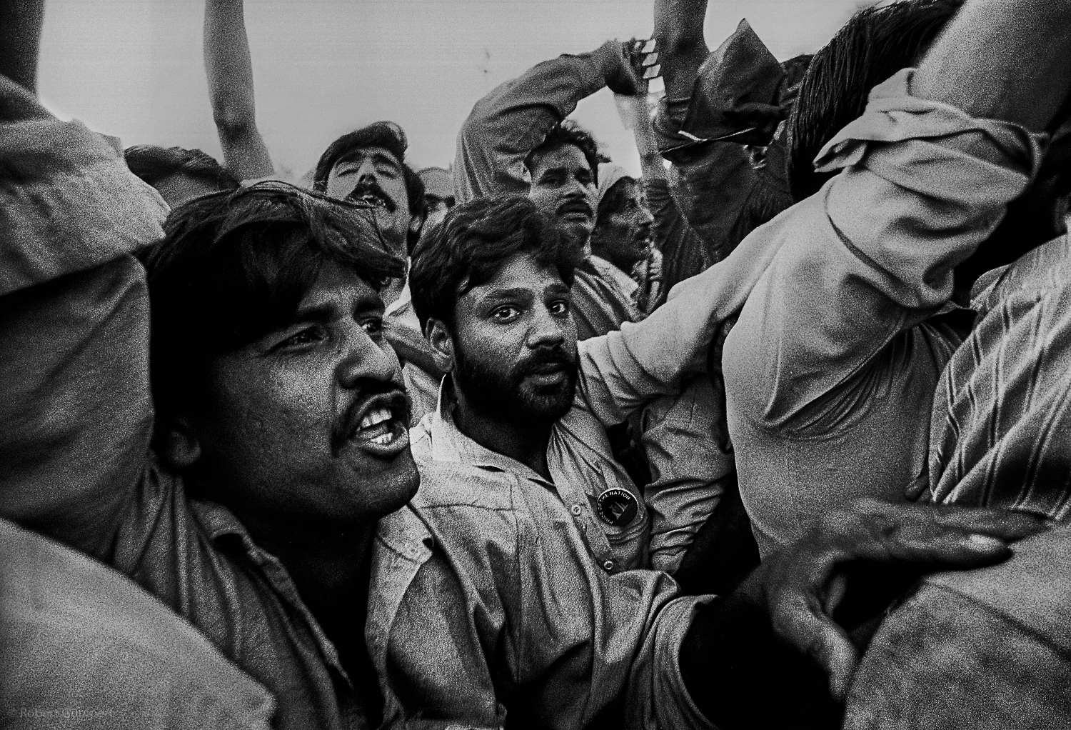 Lahore, Pakistan 1990:  Supporters of a candidate greet him as he arrives in a car carvan.