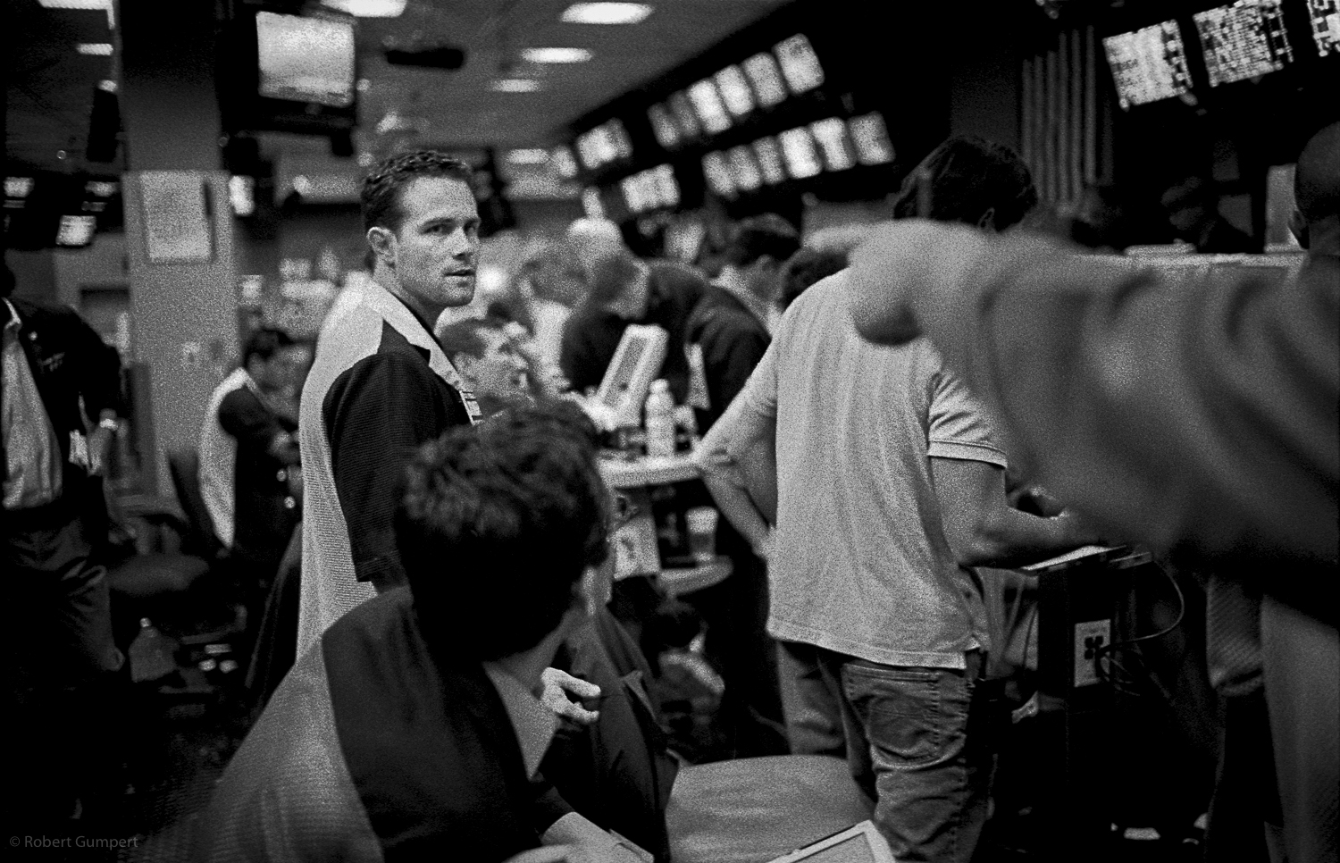 San Francisco, CA. 2003: Traders on the floor of the Pacific Exchange argue about a trade.