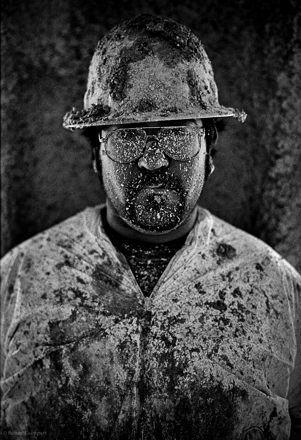 San Francisco, CA.  2000.  Apprentice contruction worker covered in insulation material.
