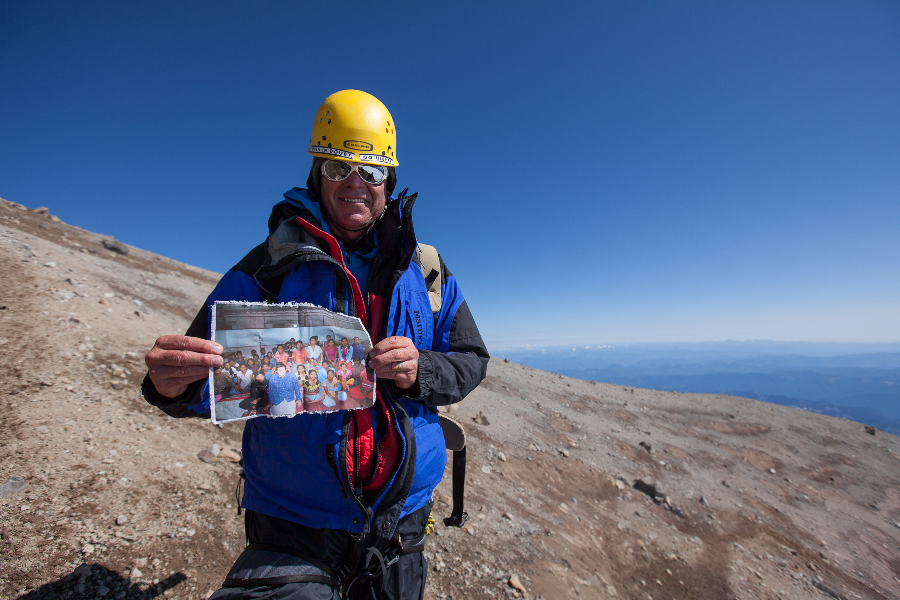 C4C climber holds a photo on the summit of Rainier. These were the girls in India who were actively praying for us as we climbed for them in 2013. He had met them in India that year, so the climb was particularly personal for him. Sound bites from the girls are often played over our walkie talkies from our base camp crew while we are on the mountain. It. Is. Intense.