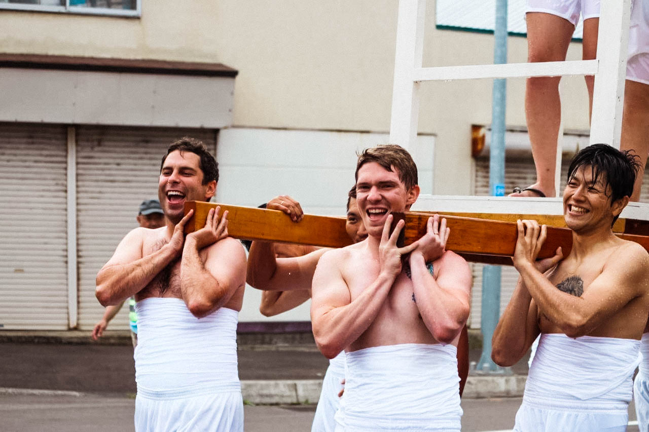 (From left to right) Danny, Peter, and Daigo holding the mikoshi. Photo by Koichi Matsuda