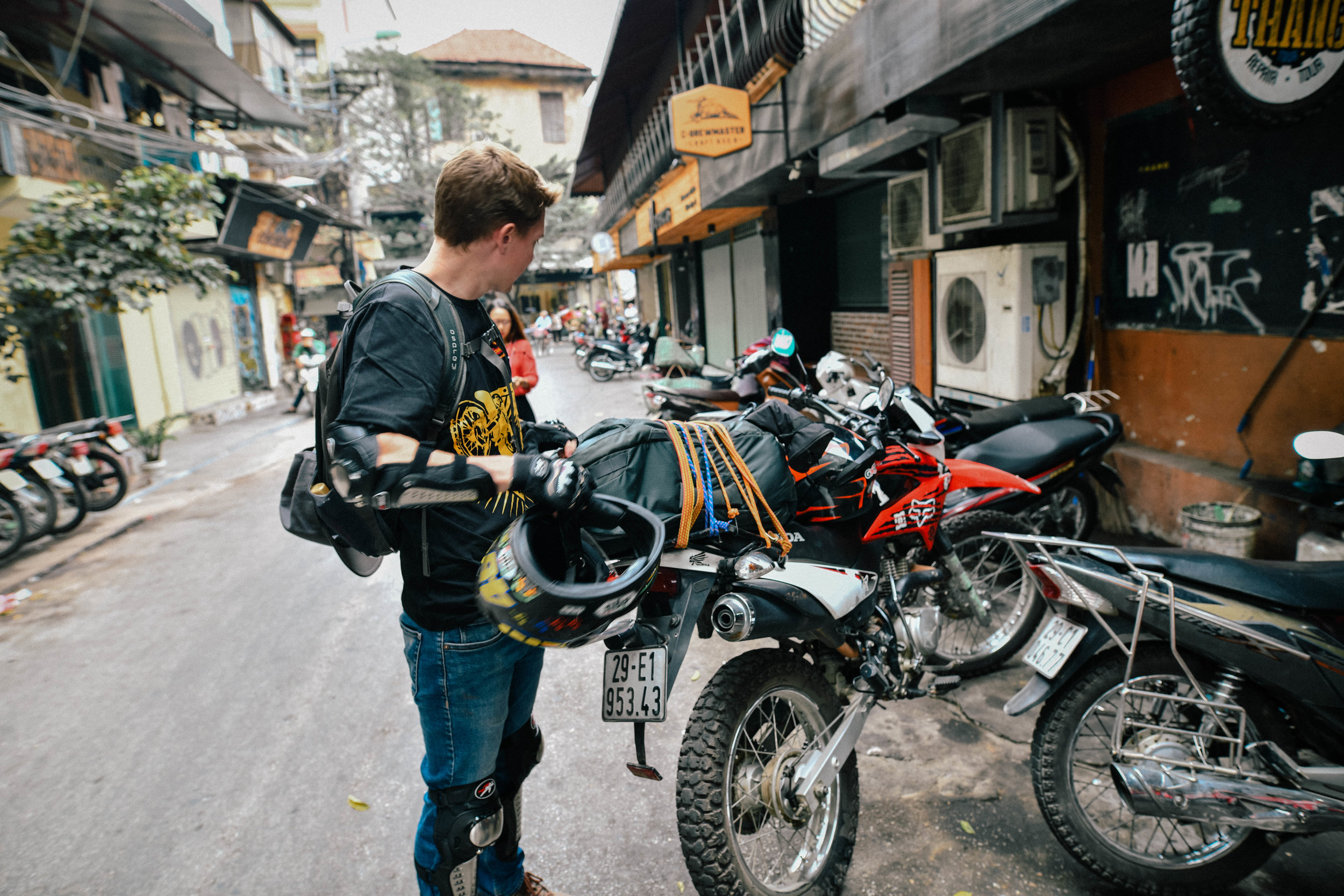 getting motobikes ready in the streets of hanoi