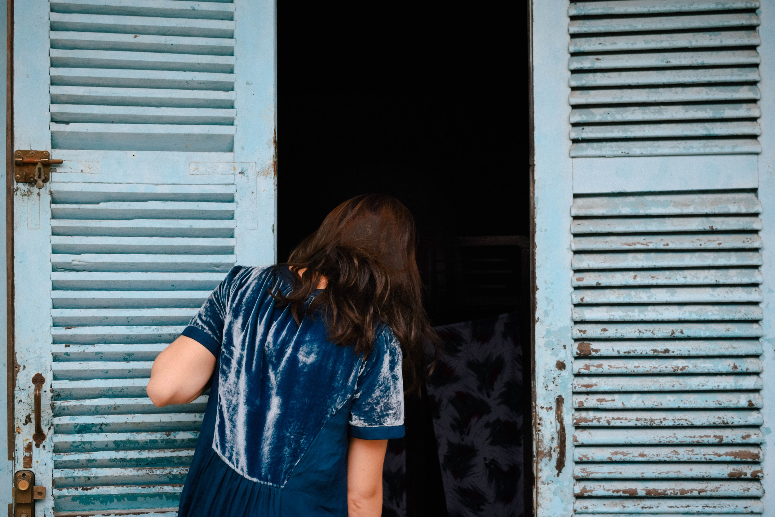 Blue door and dress in Hoi An