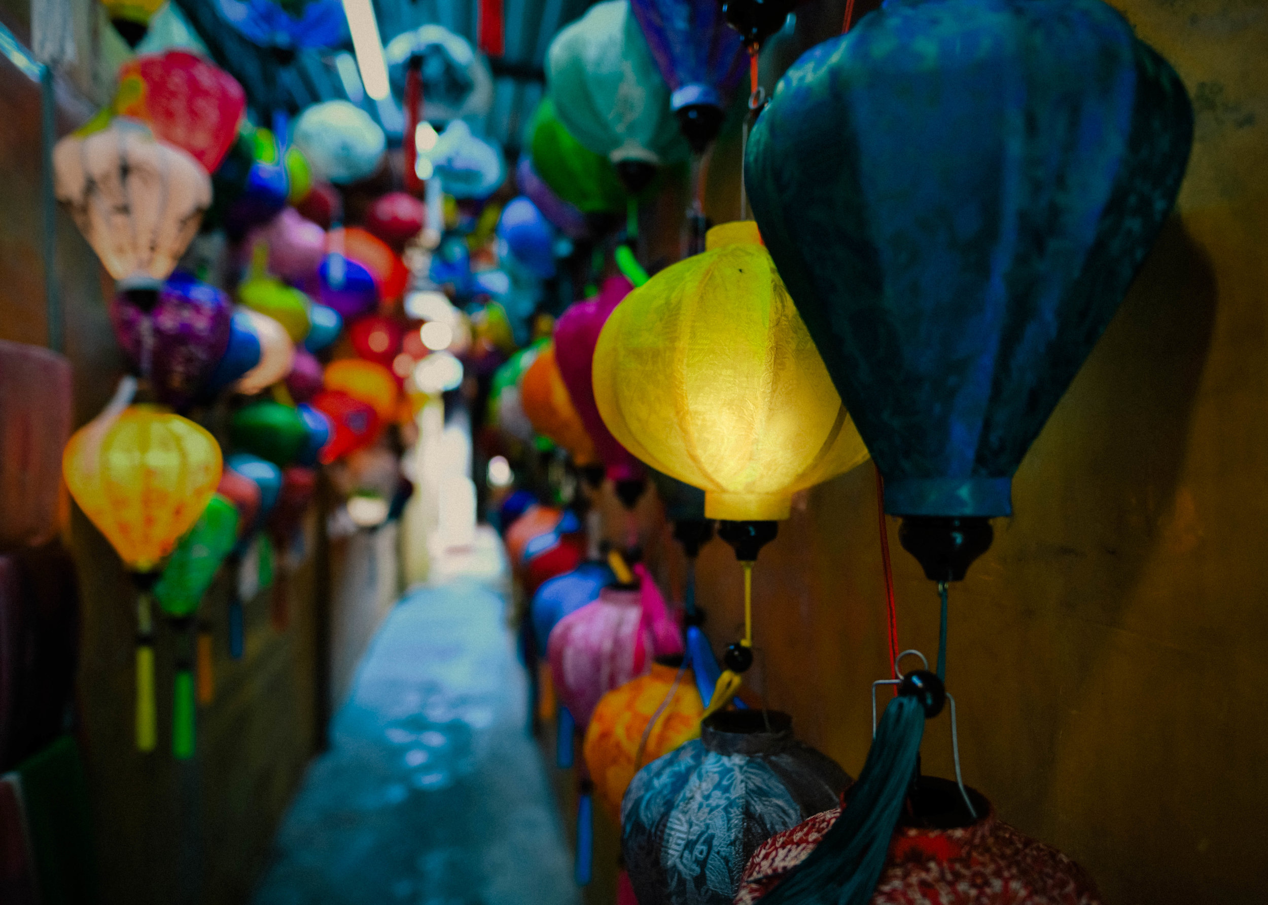 Lit lantern in an alleyway in Hoi An