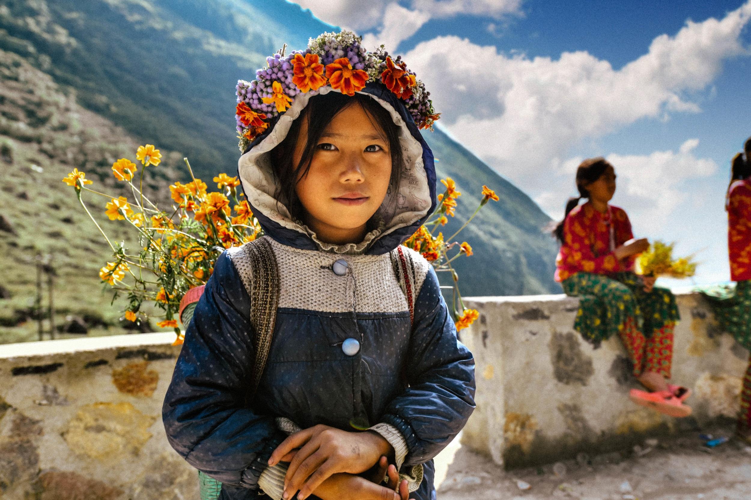 Hmong flower girl in traditional dress