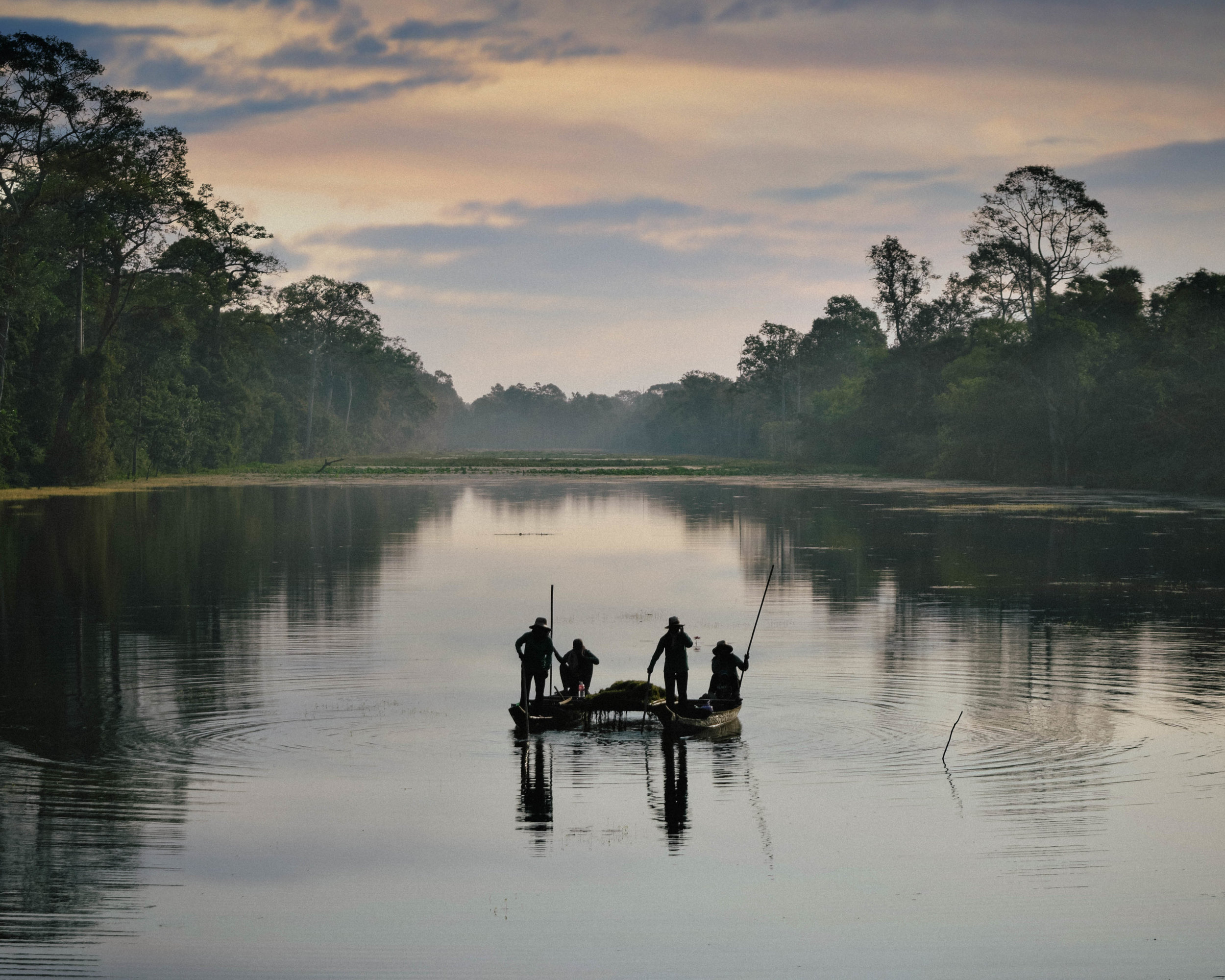 Fisherman at sunrise in Angkor Wat, Cambodia