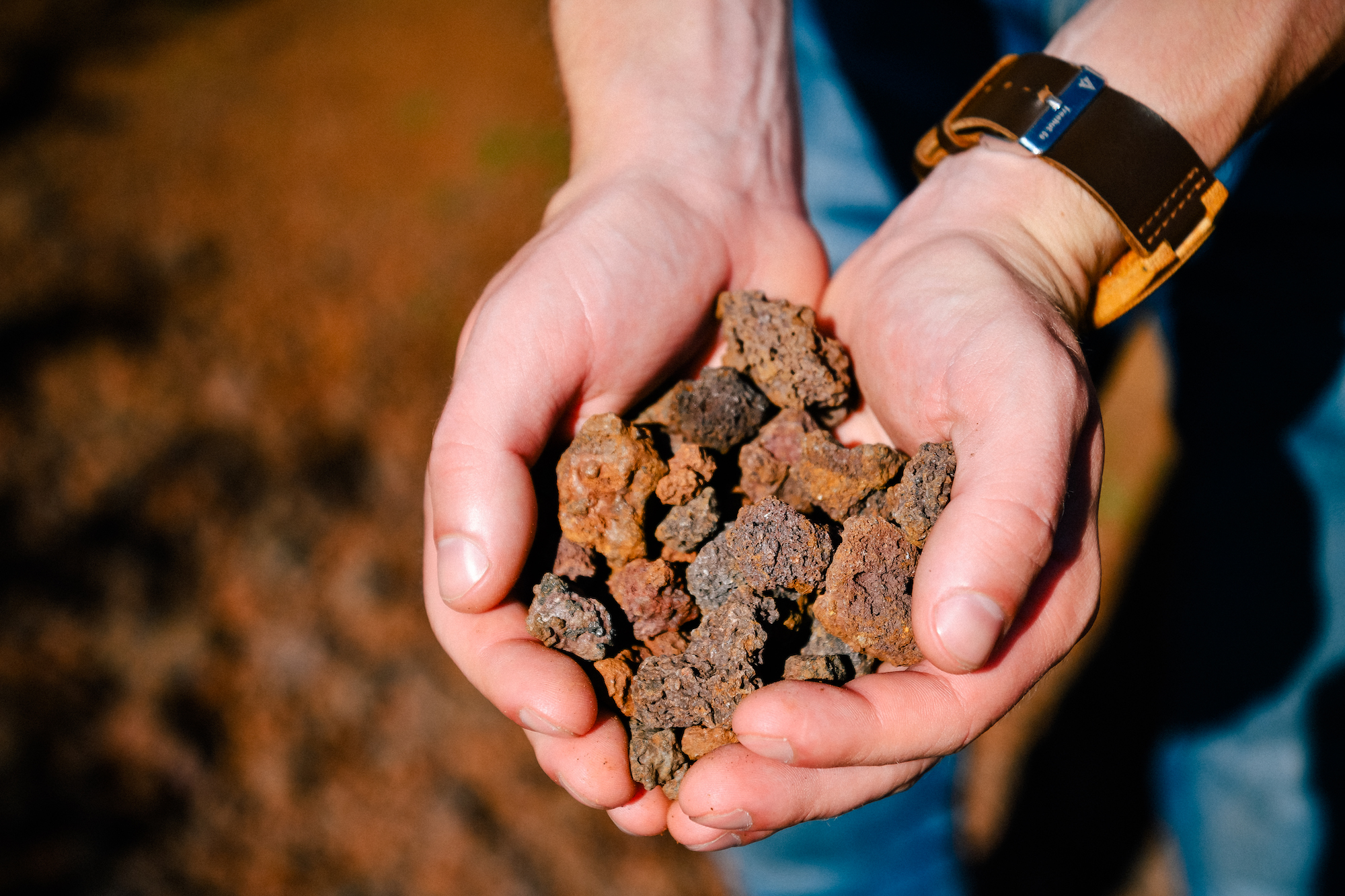 holding some of the volcanic rock