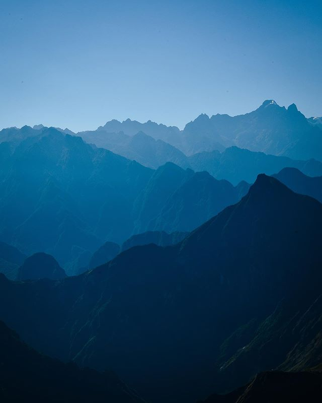 After a year of travel, this was one of my favorite sights so far. I took this picture along the fourth day of the Salkantay Trek to Machu Picchu - it was a difficult day of over 30 kilometers hiking (about 19 miles), but made so worthwhile for views like this. Shades of blue peaks set against a cloudless sky. . . . . . . #mytinyatlas #stayandwander #passionpassport #nowherediary #optoutside #getoutside #somewheremag #dametraveler #timeoutsociety #globalcaptures #somewheremagazine #traveldeeper #suitcasetravels #mytinyatlashello #travelherway #hiking #neverstopexploring #travelblog #wanderlust #mountains #travelbloggers #machupicchu #sacredvalley #girlswhohike #gominimalmag #southamerica #salkantaytrek #peru #layeredmountains #blue