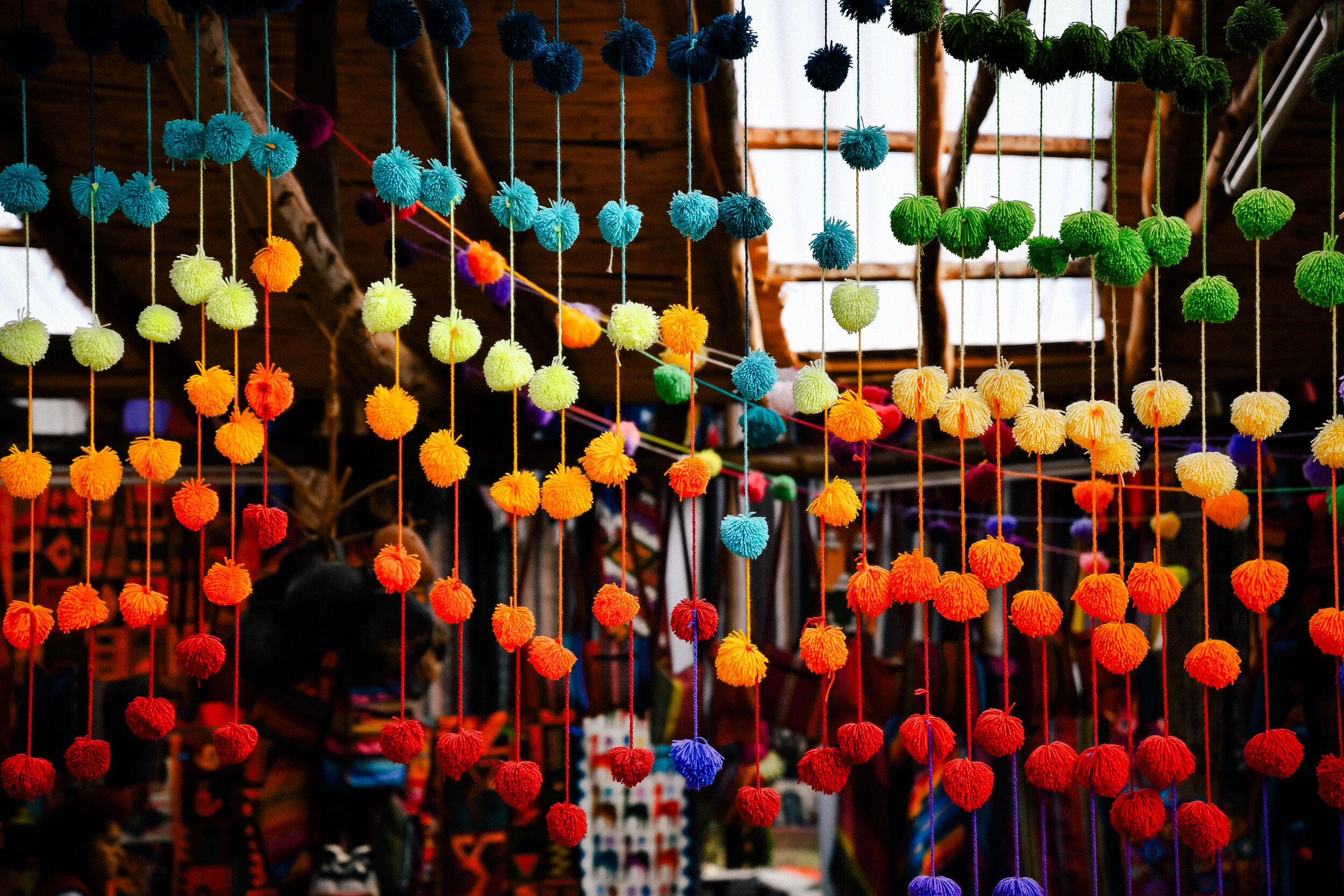 dyed puff balls in Chinchero