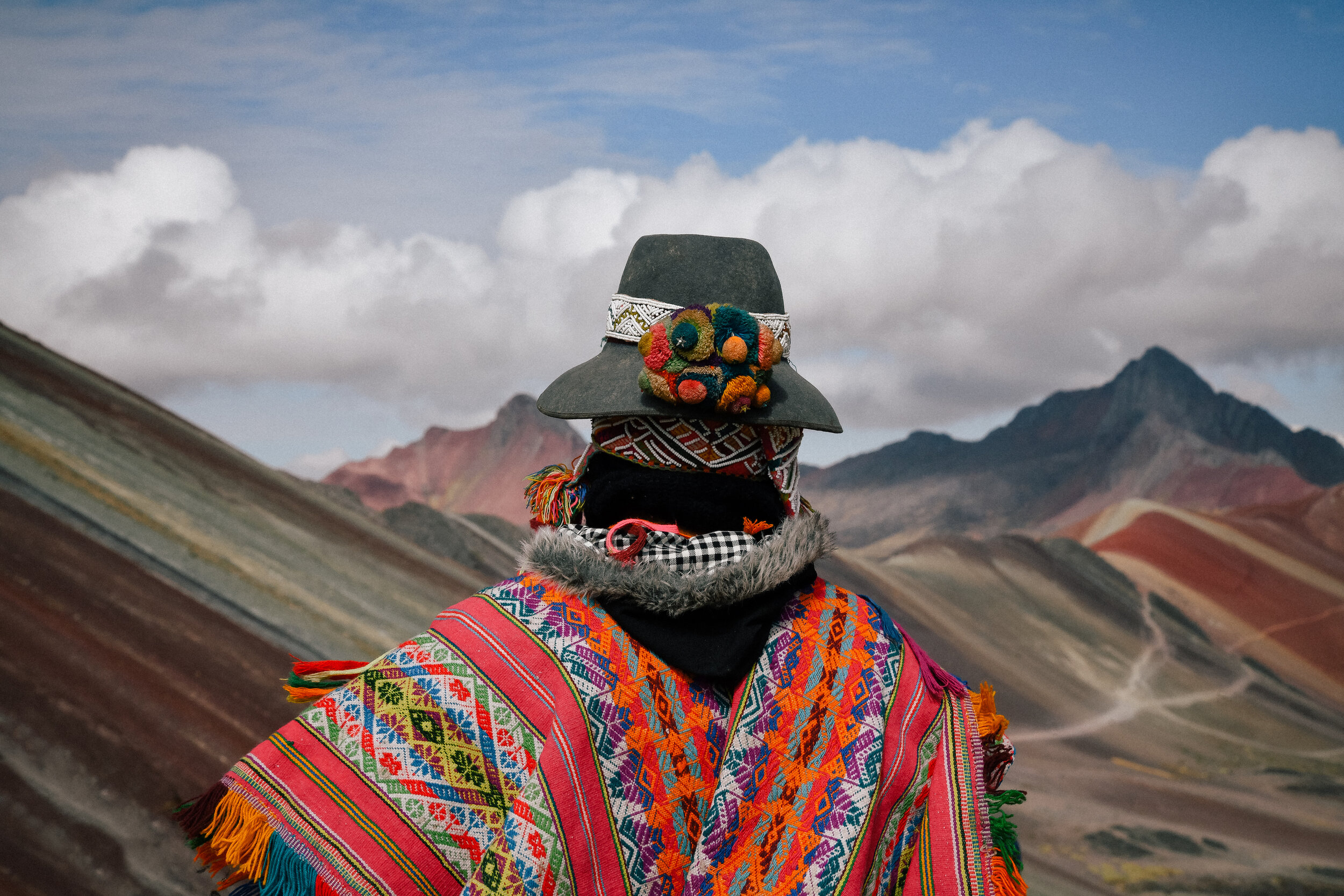 A man beautifully dressed at Rainbow Mountain!