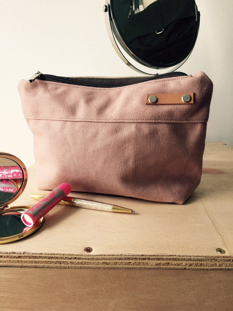 Kelly Cosmetic Pouch - Pink Travel Pouch —Your cosmetic essential storage accessories. We'll do the engraved your unique name on top of the tiny leather piece.By Designer Christy Foh.