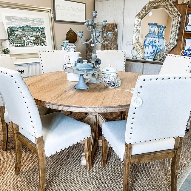 a whole new look today thanks to the amazing staging design by @embellisheddwelling | gorgeous 60inch round dining table with 6 parsons chairs delivered & now available on the floor