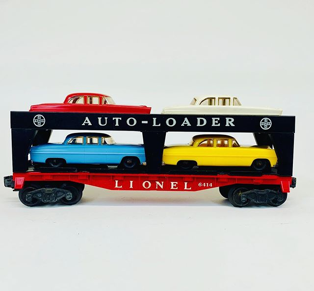 Lionel 6414 with very rare robin egg blue automobile.  We have only had a few of these over the years.
