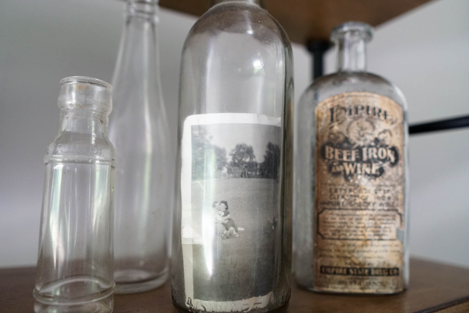 An antique bottle to display one of my favorite family photos.