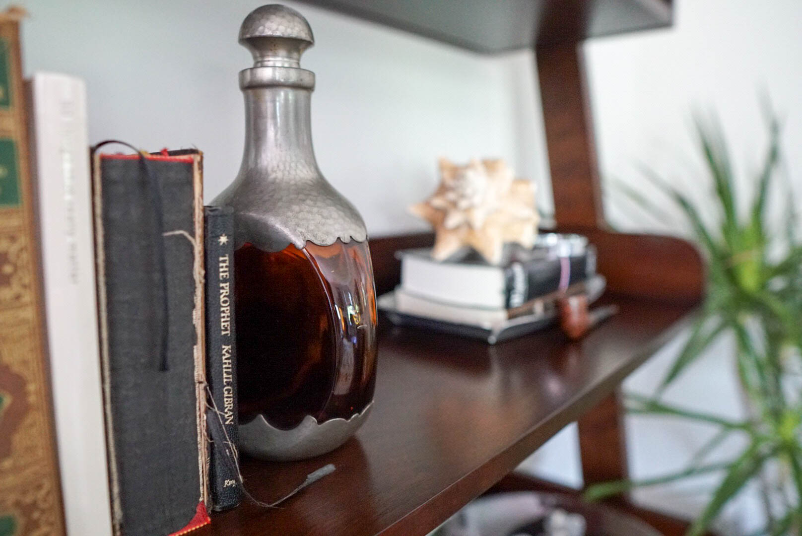 Pop-Pop's antique liquor bottle serves as the perfect bookend (and his old pipe).