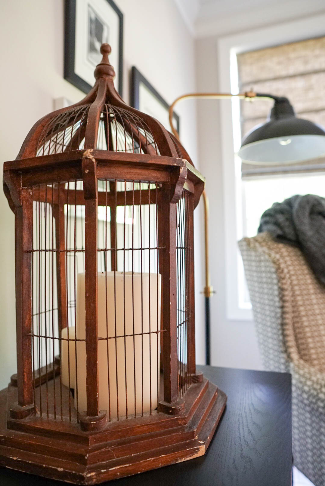 Vintage birdcage adds balance, texture and interest on our media console.