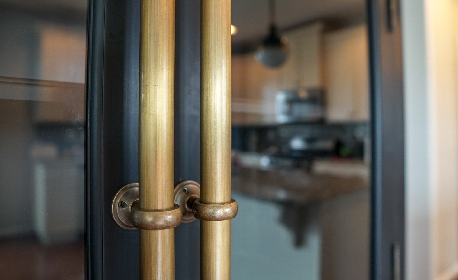 Black-Kitchen-Cabinet-Brass-Hardware.jpg
