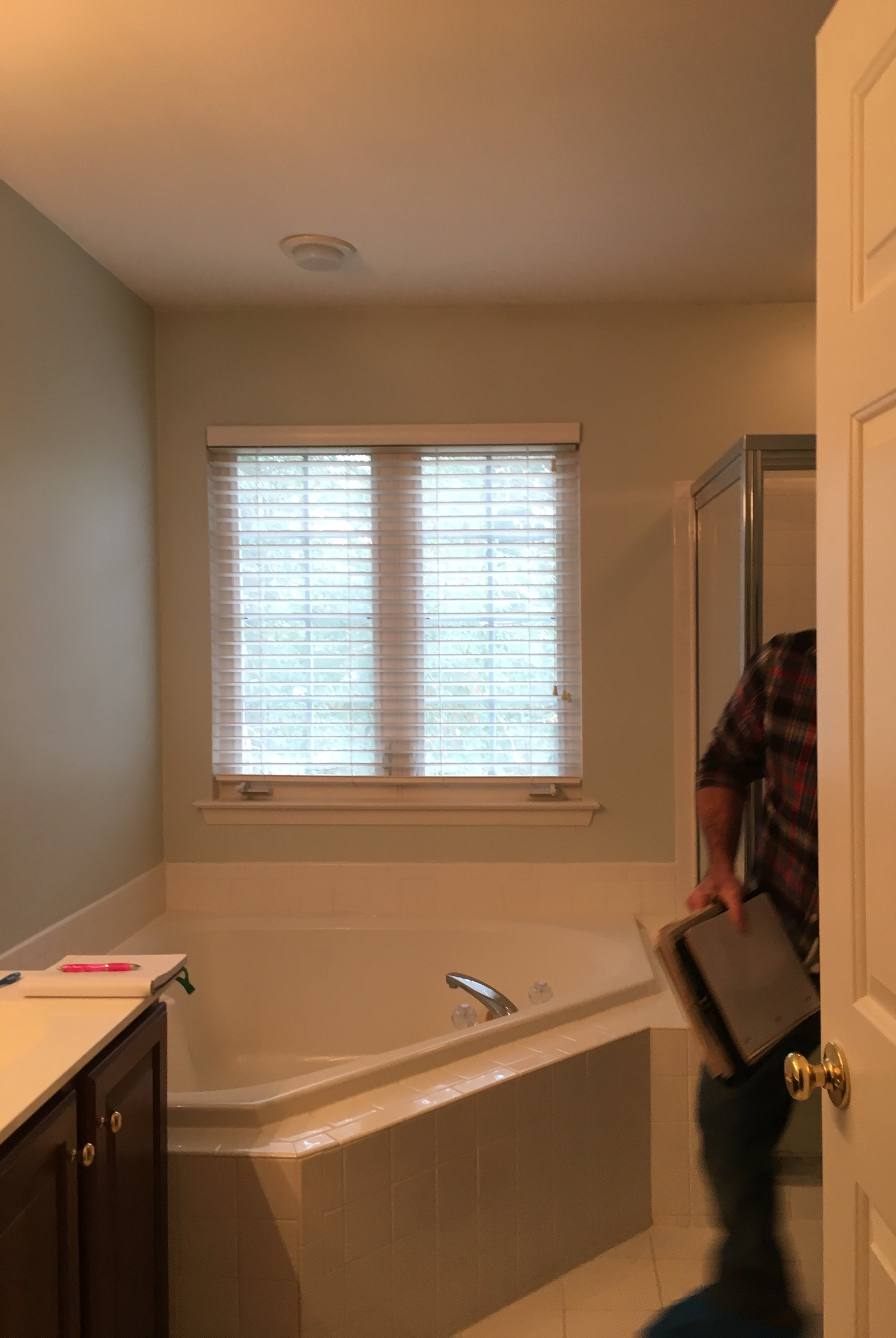 BEFORE: Typical 90's, new-construction master bathroom with corner whirlpool tub.