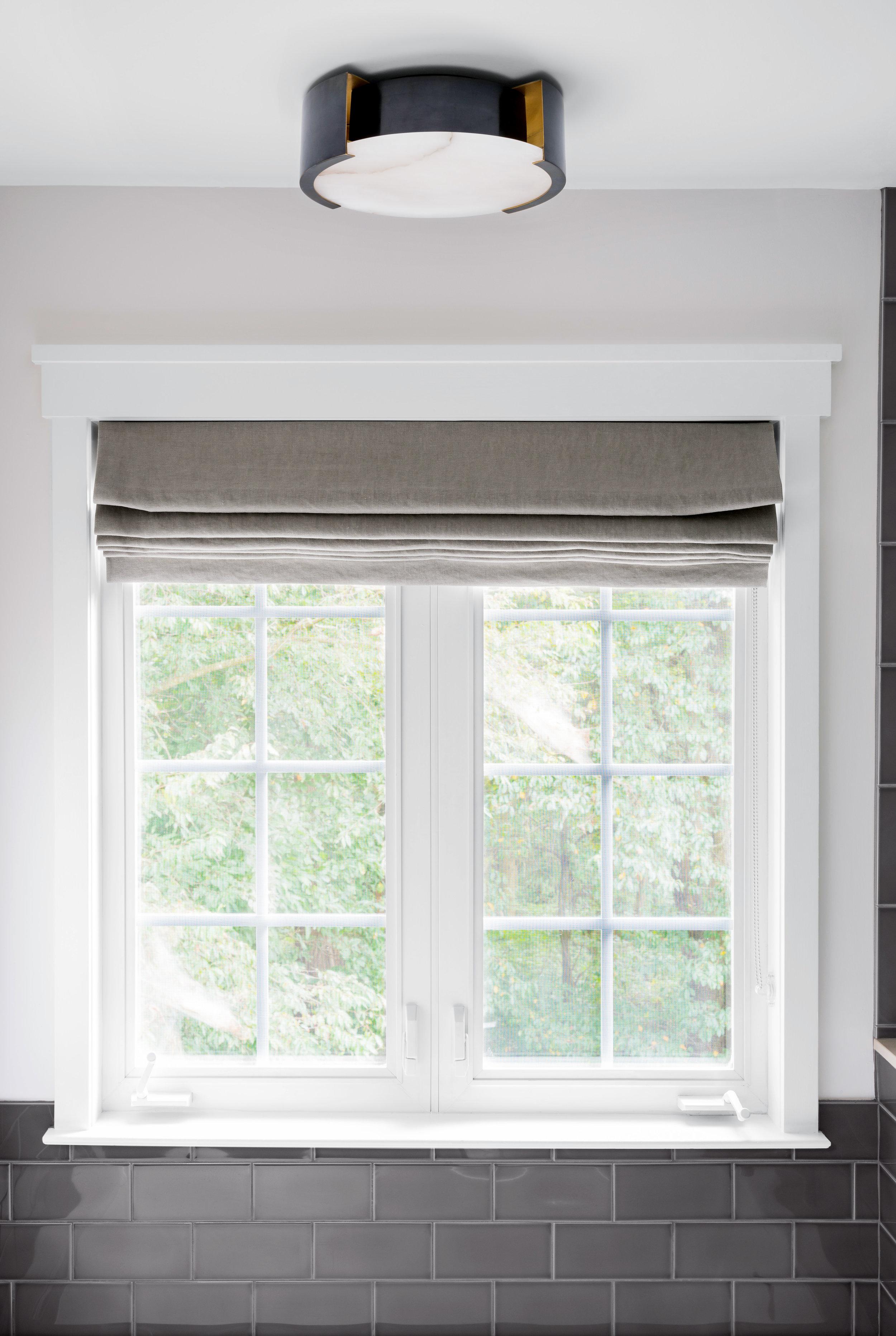 AFTER: Modern flushmount light, updated window millwork and custom roman shade.
