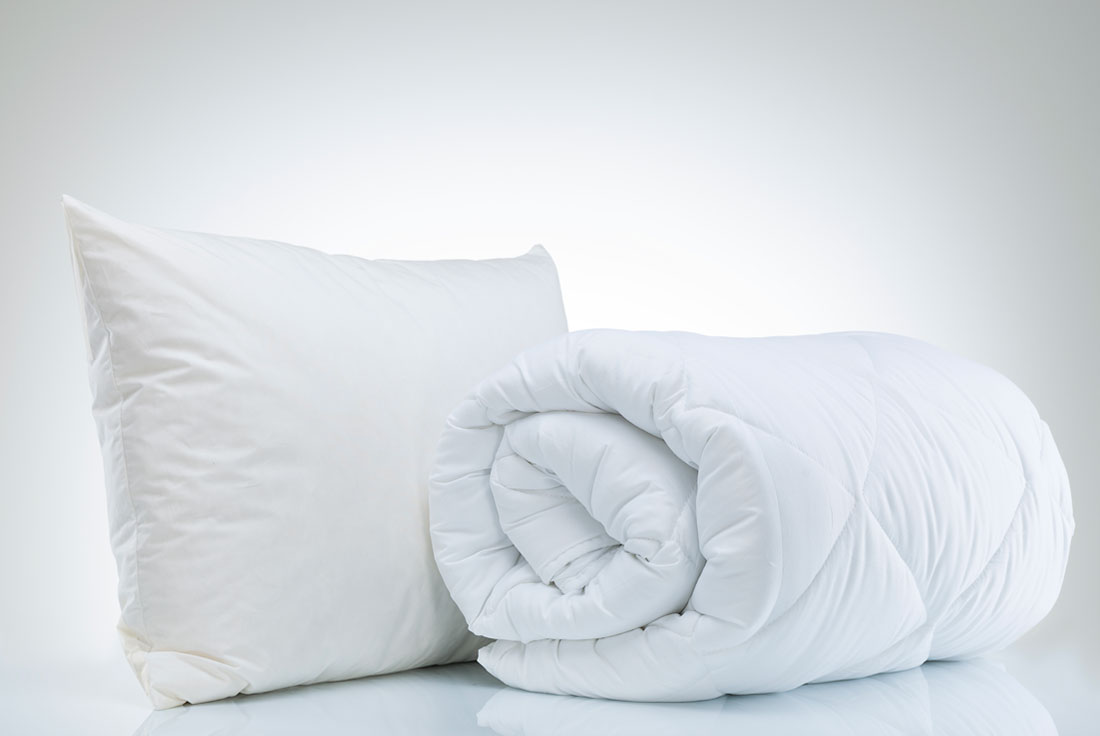 """Bed Basics - From pillows and duvets to mattress and pillow protectors, our lines of """"white goods"""" are designed with a good night's sleep in mind. We offer comprehensive product lines from value-driven price points to luxury brand collections. We also offer licensed and national brand lines made to order."""