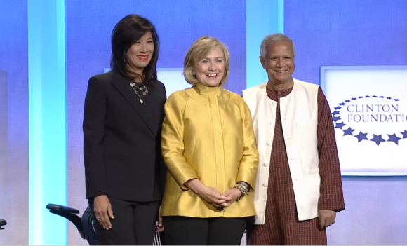 Grameen America President and CEO Andrea Jung, Secretary Hillary Clinton, and Grameen America Chair Muhammad Yunus on stage at the 2014 Clinton Global Initiative Annual Meeting