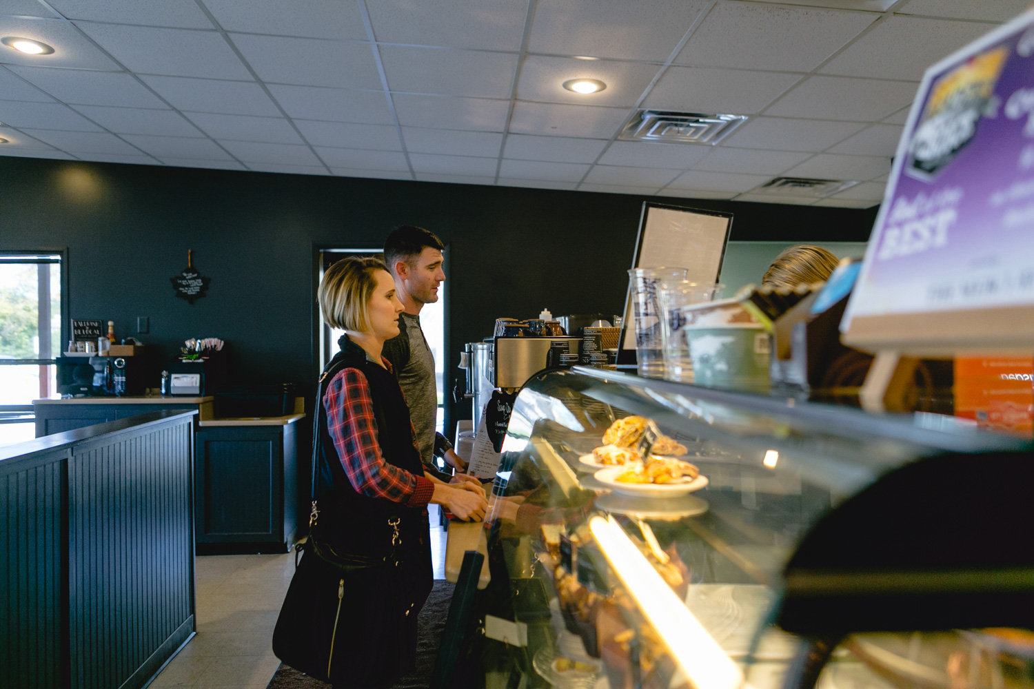 Radina's Coffee House, Manhattan, Kansas. Couple Photography Session captured by Renee McDaniel, documentary and lifestyle photographer with Renee McDaniel Photography
