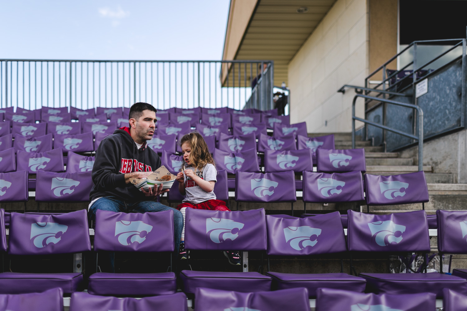 Captured by Best Documentary Family Photographer, Renee McDaniel of Renee McDaniel Photography in Manhattan Kansas. Photographed at Tointon Family Stadium, Kansas State University, Manhattan Kansas.