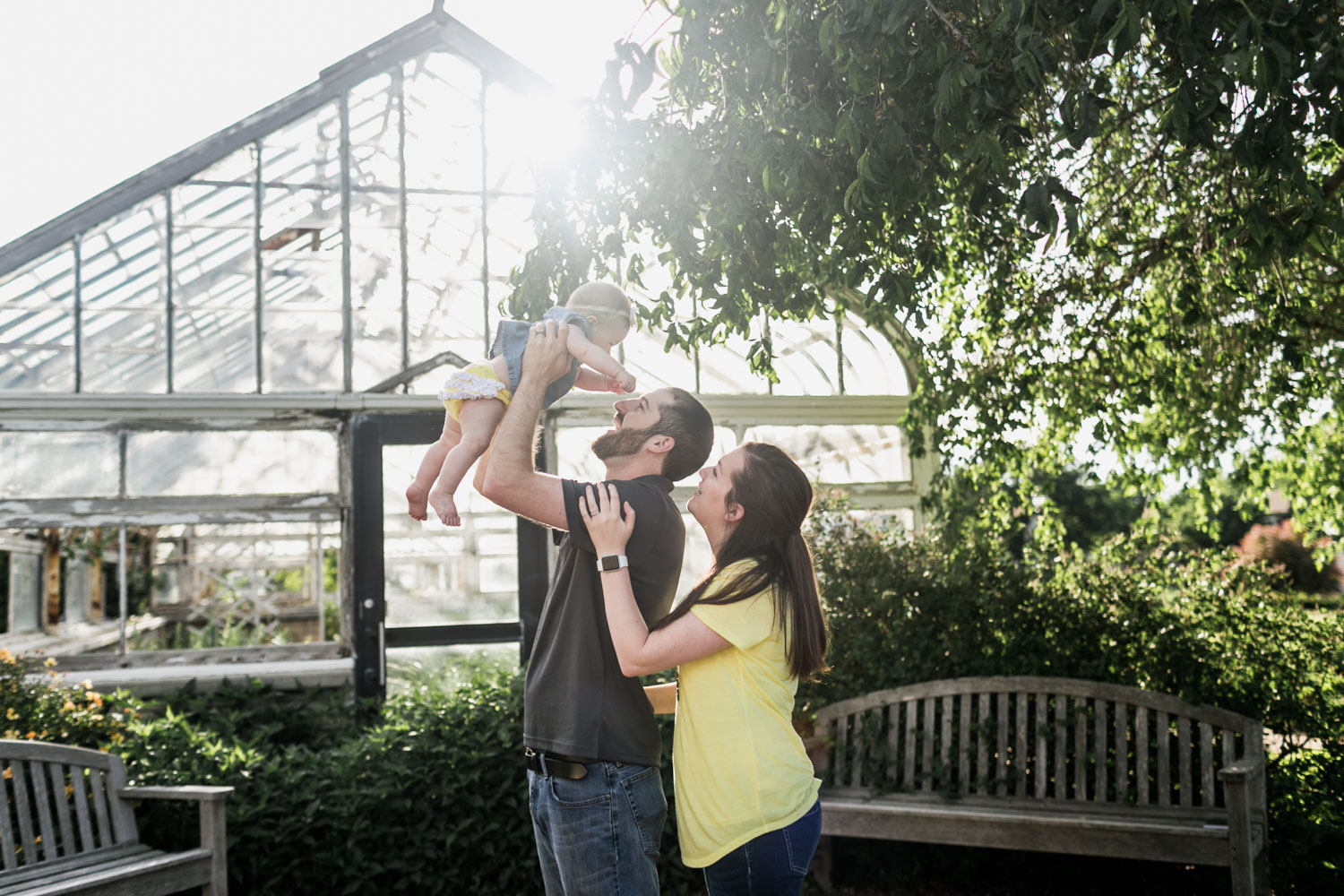 Family laughing and spending time together during a Lifestyle Photography Session at Kansas State University Gardens in Manhattan, Kansas.