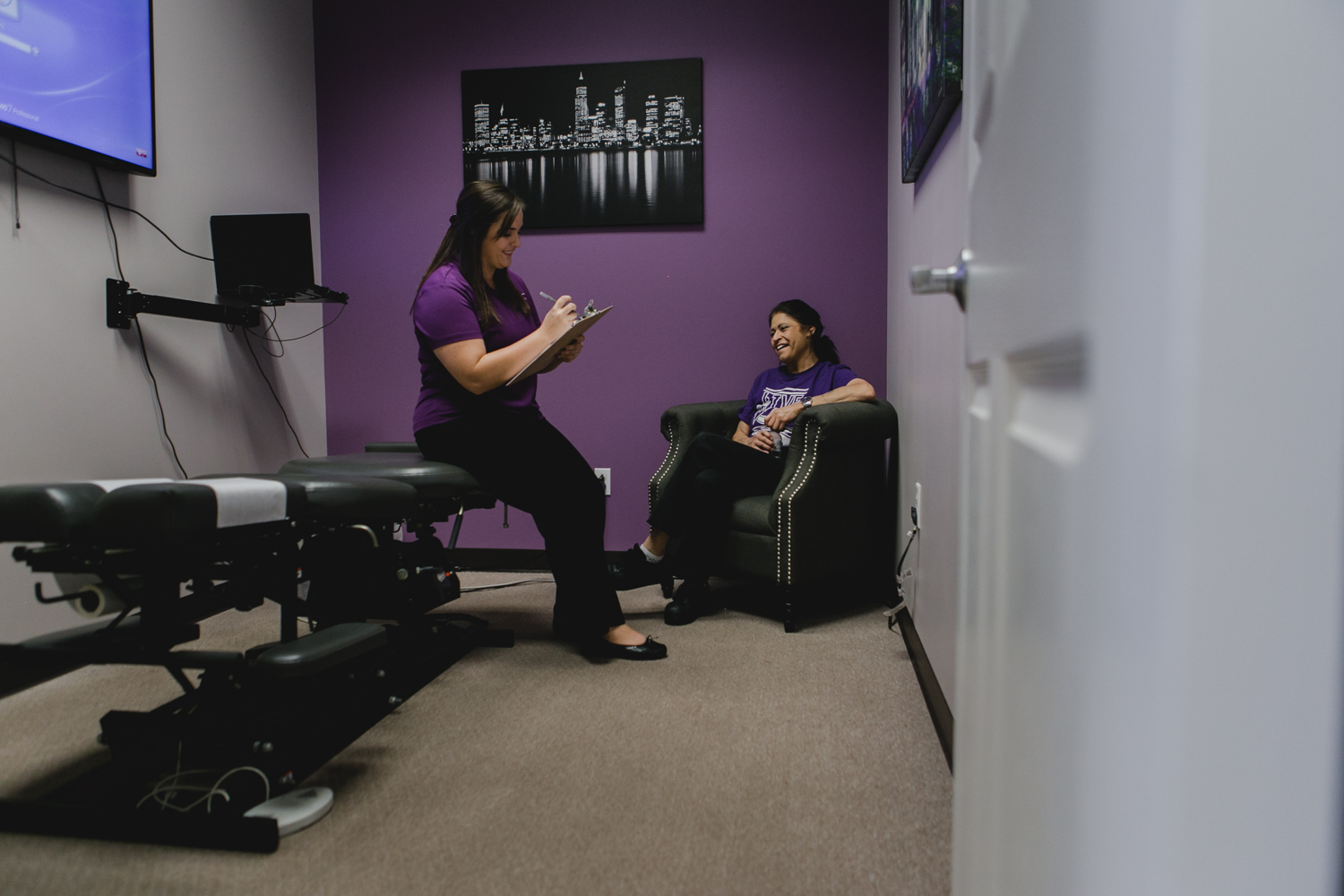 Commercial Branding Photography Chiropractic assistant with patient Manhattan Kansas